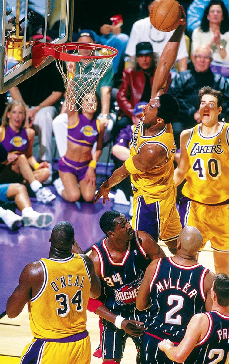 1999-0228-Kobe-Bryant-Hakeem-Olajuwon-LAK03S.jpg