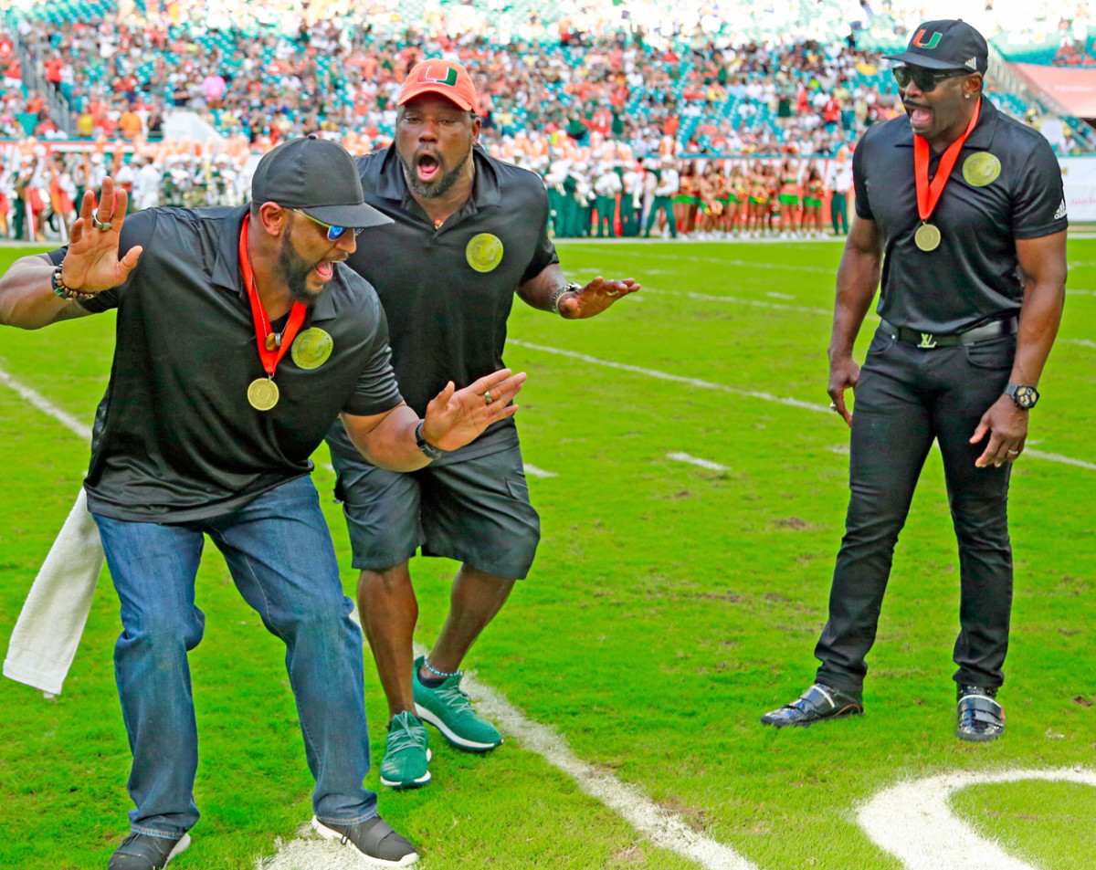 Sapp (center) with Ray Lewis and Michael Irvin at the October Ring of Honor ceremony.