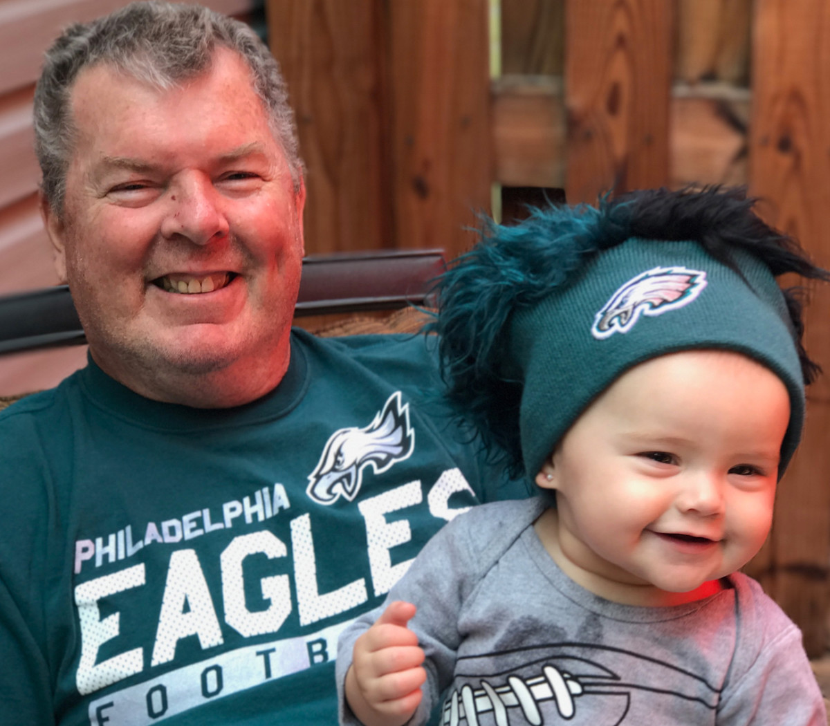 Wayne with granddaughter Henley, a budding Eagles fan.
