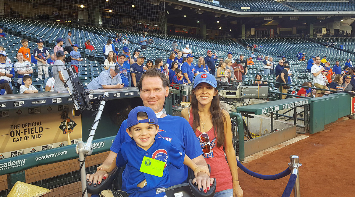 Steve Gleason, his son Rivers and his wife Michel take in a Cubs game.