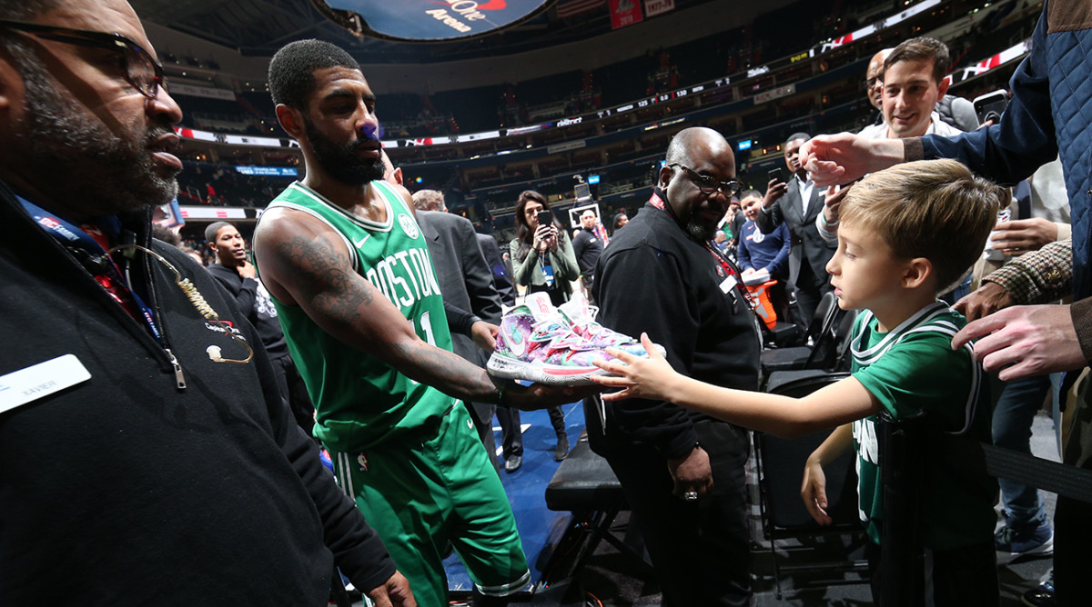 kyrie-irving-gives-sneakers-to-fan.jpg