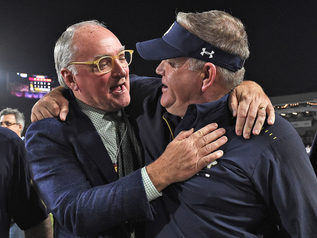 Notre Dame AD Jack Swarbrick (left) and coach Brian Kelly celebrate after the Irish capped off a 12–0 regular season with a win at USC on Nov. 24, 2018.