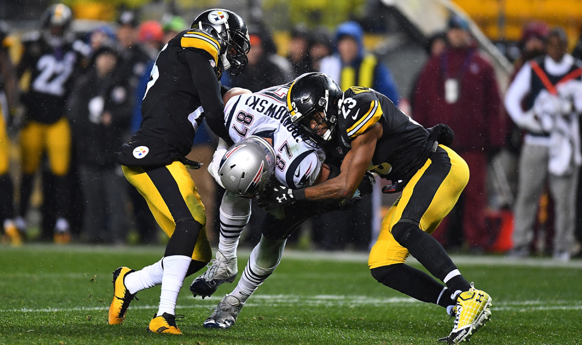Mike Mitchell (23) and Artie Burns (25) wrap up Rob Gronkowski in Week 15.