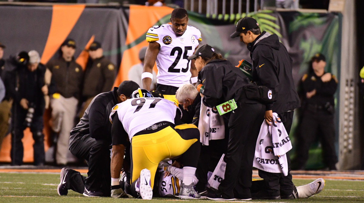 Cameron Heyward and Artie Burns look on as Shazier is attended to after the hit in the Cincinnati game.