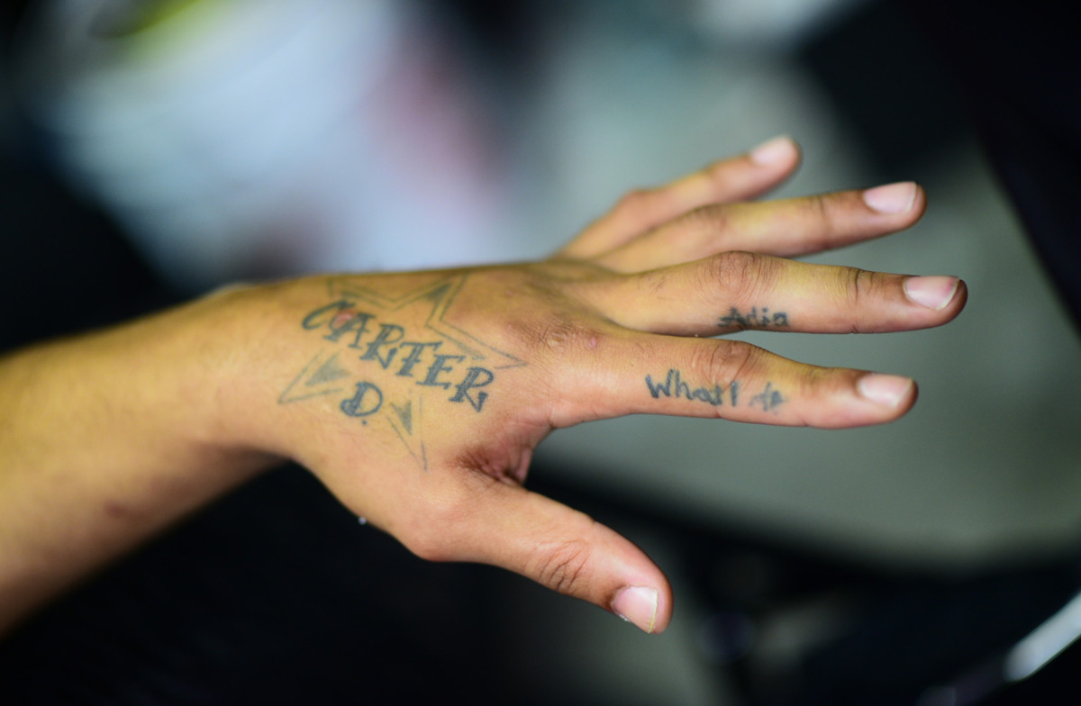Hardy has his son's name, and a Cowboys star, tattooed on his hand.