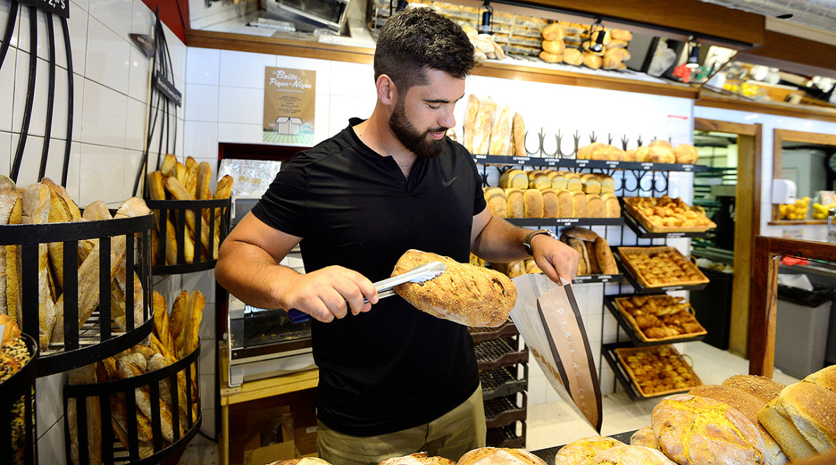 Duvernay-Tardif picks up some bread and pastries from his parents' bakery.