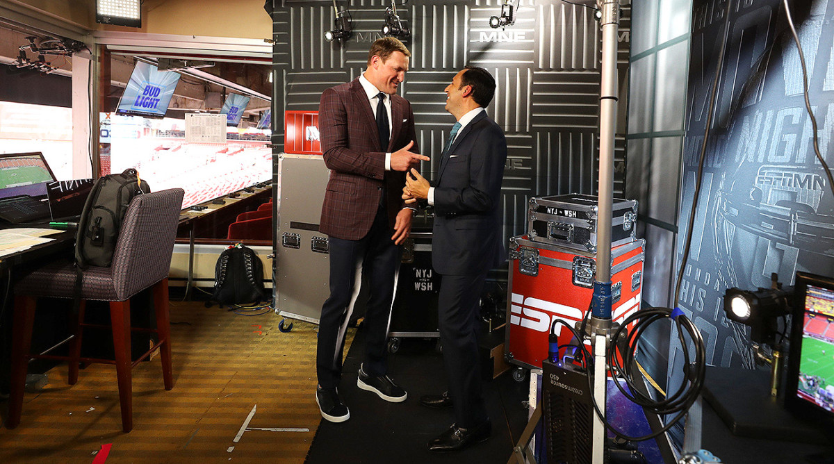 Jason Witten and ESPN play-by-play announcer Joe Tessitore (right) have a lighthearted moment before their broadcast.