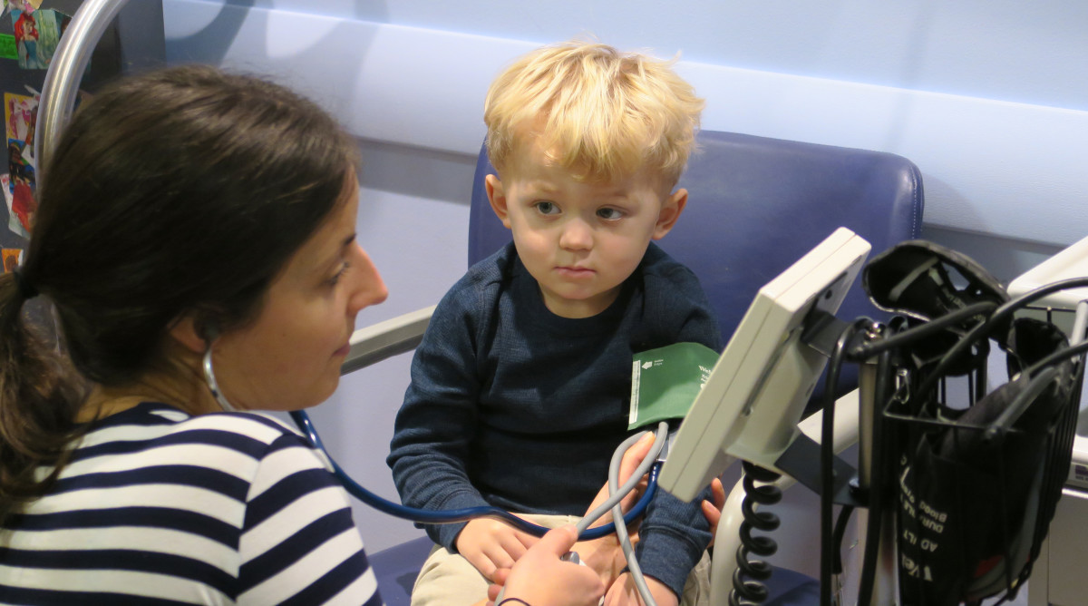 Hudson gets his vitals checked.