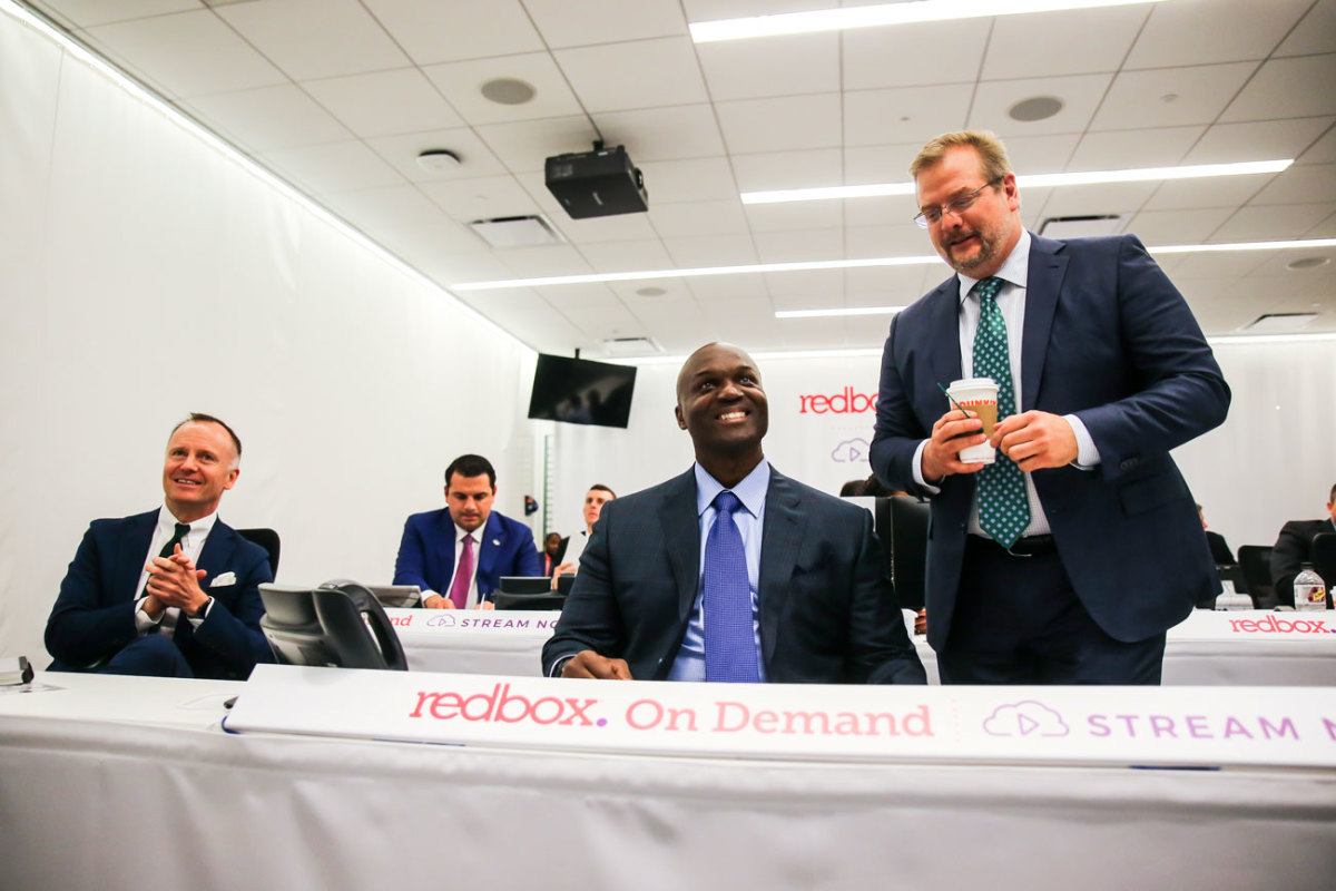 Christopher Johnson, Todd Bowles and Mike Maccagnan are all smiles on draft night.
