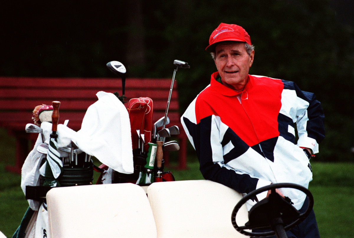 Bush with his golf clubs in 1991.