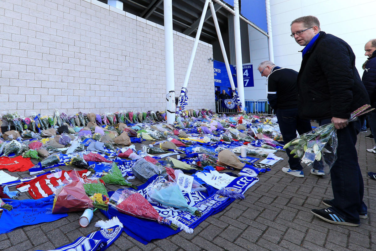 mourners-pay-tribute-after-helicopter-crash-at-king-power-stadium-in-leicester-5bd62c2be3e027688e000001.jpg