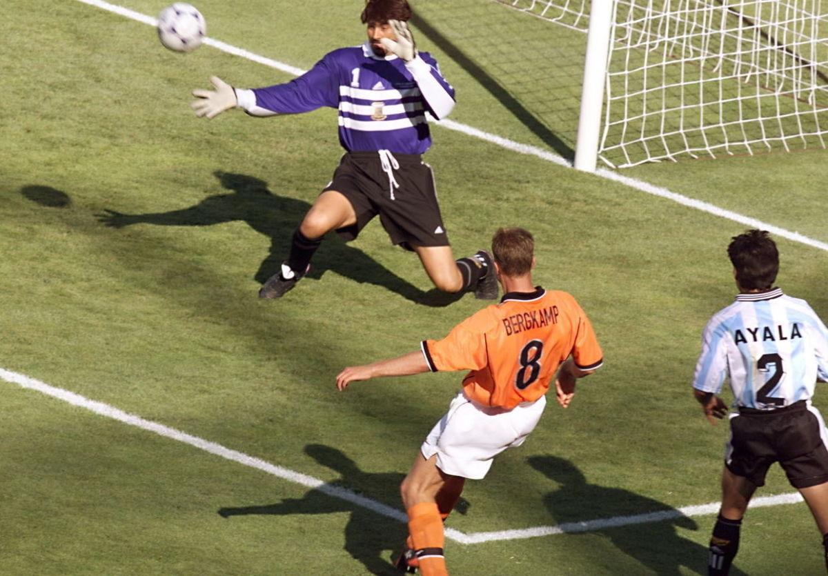 dutch-forward-dennis-bergkamp-kicks-the-ball-past-5af711267134f64eeb000001.jpg