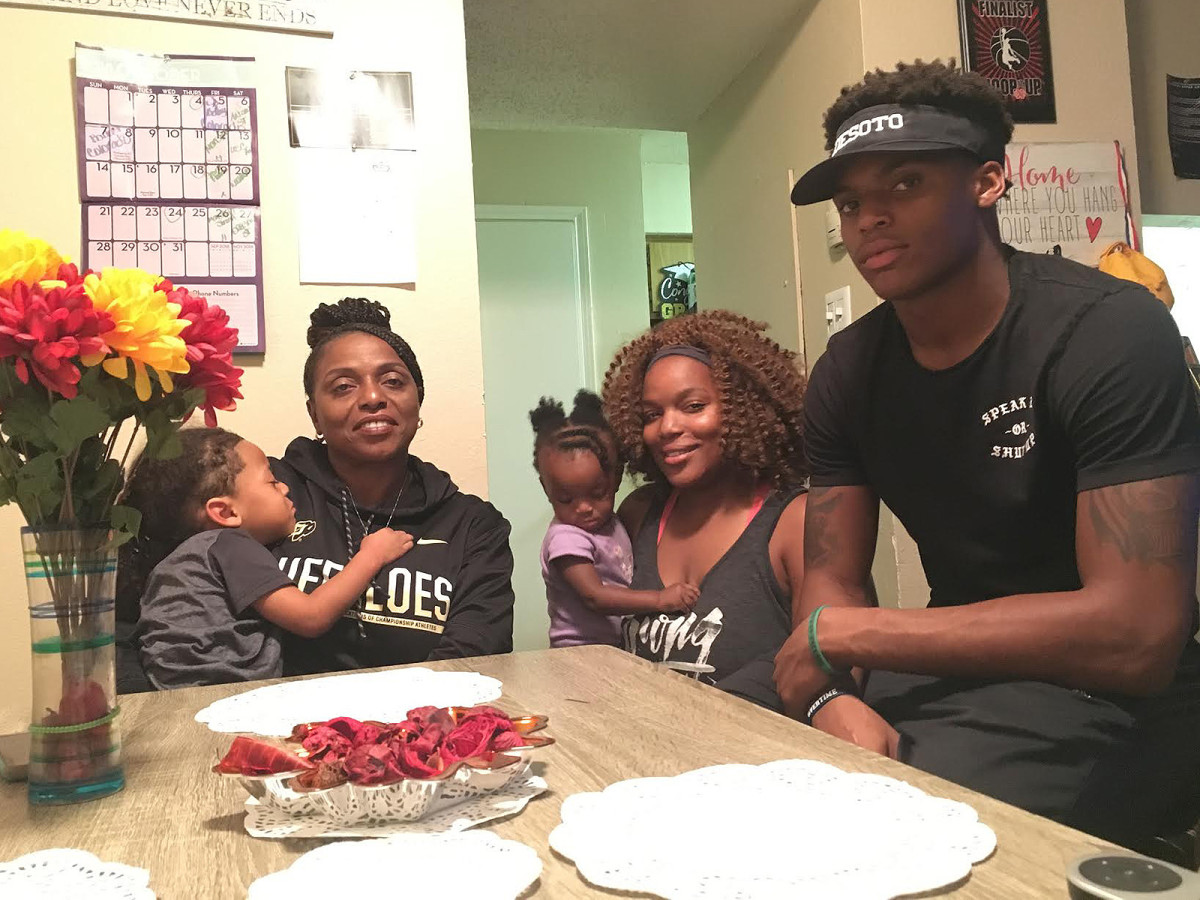 Laviska Shenault Jr.'s family sits around a small dining room table earlier this week in the Dallas suburb of DeSoto. Mom Annie, sister Tyanna and brother La'Vontae hold watch parties for Colorado games.