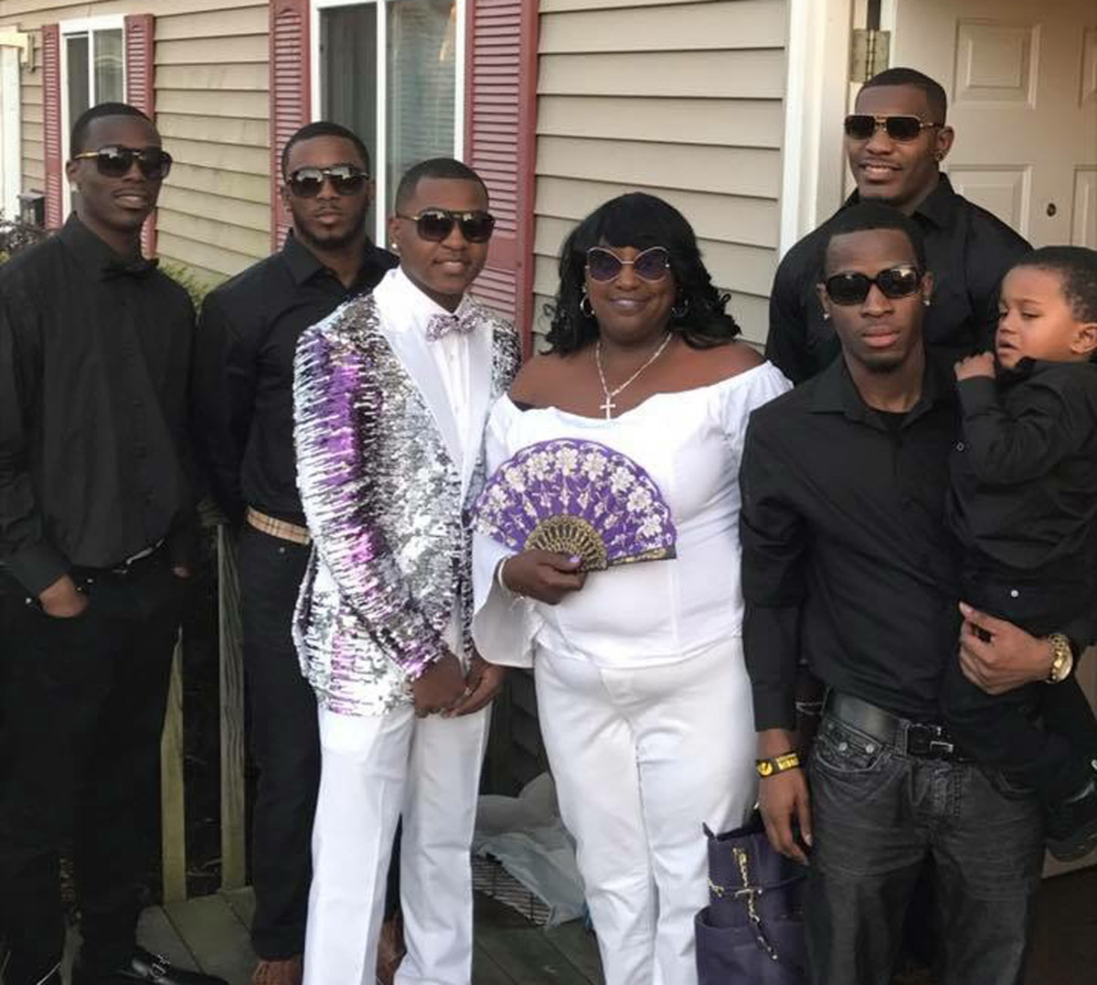 Devon, with mom Yvette, Desmond (back row right) and the rest of the prom crew.
