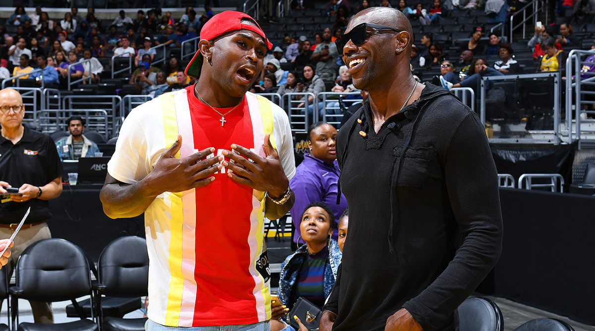 Terrell Owens and Julio Jones take in a WNBA game between the Sparks and the Storm at the Staples Center in Los Angeles.