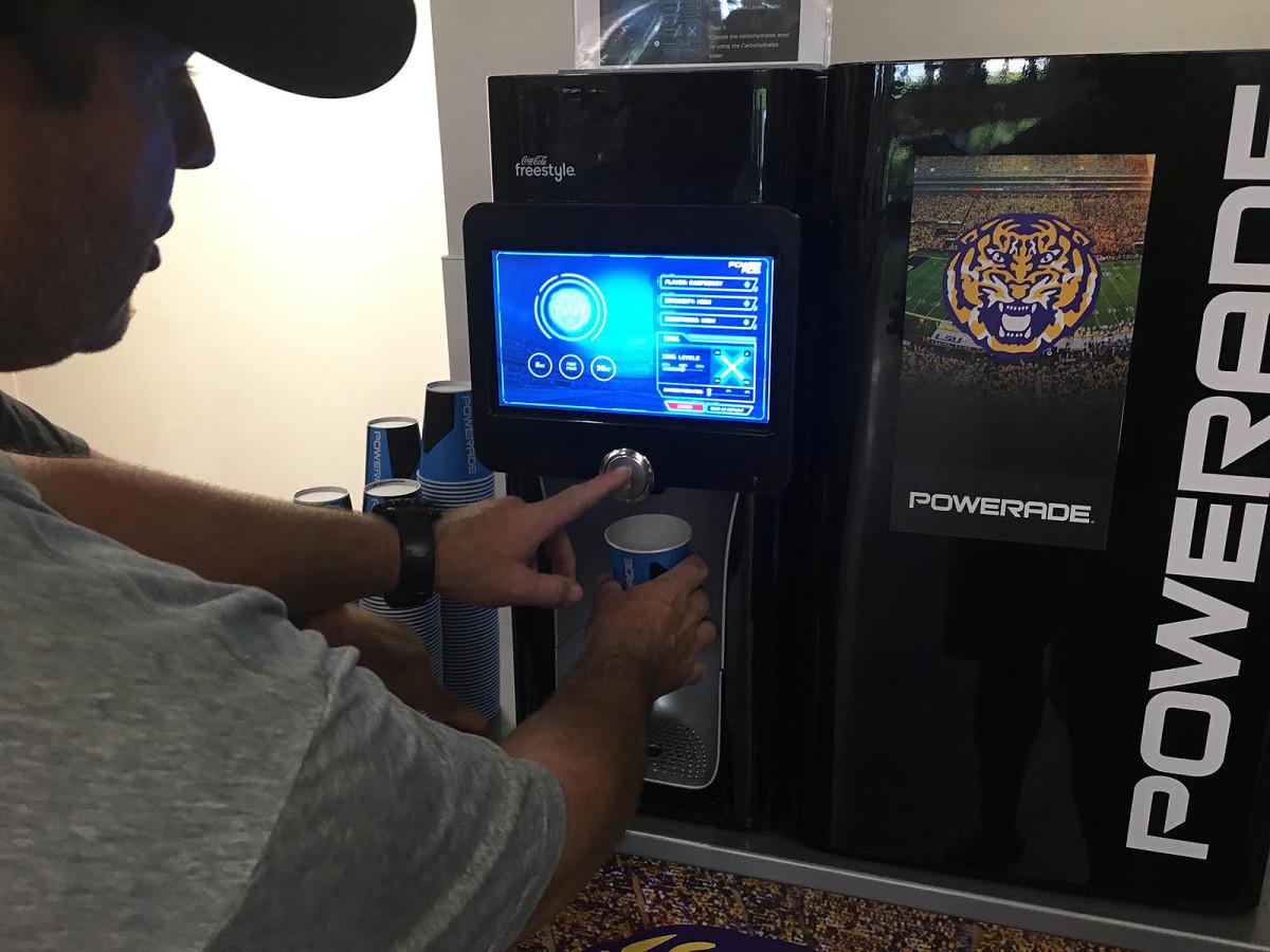 Equipment director Greg Stringfellow uses LSU's new Powerade dispensing machine.
