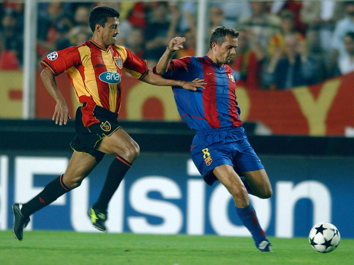 phillip-cocu-of-barcelona-is-challenged-by-trevino-sergio-almaguer-of-galatasaray-5bfd8102f30be4f238000001.jpg