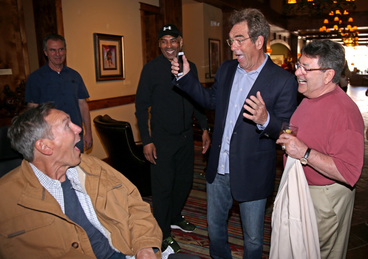 Huey Lewis surprises his fellow Musketeer as Roger Craig and Eddie DeBartolo look on.