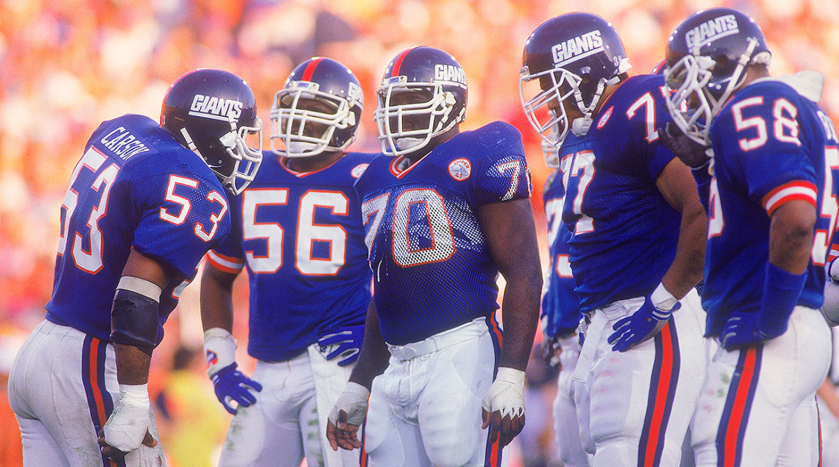 Harry Carson (left) and the Giants defeated the Broncos in Super Bowl XXI.