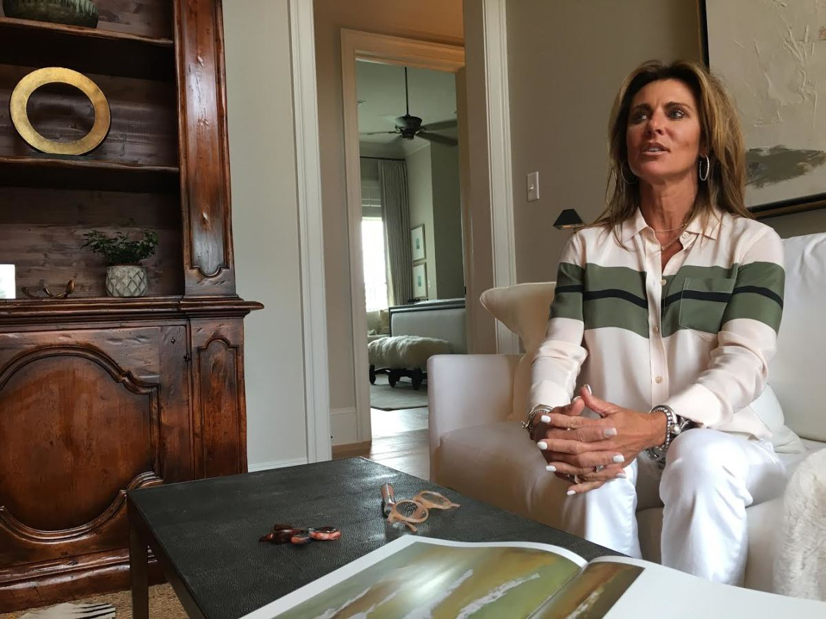 """Kelly Orgeron, a mother of three and wife to LSU football coach Ed Orgeron, is seated in what she refers to as her """"prayer room"""" in the couples' home in Baton Rouge."""