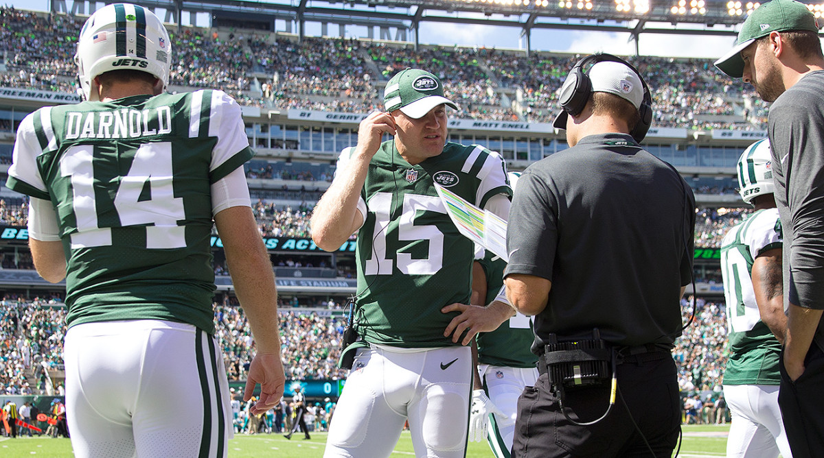 Josh McCown (No. 15) acts like a coach for Darnold, debriefing him after every drive about his decisions.