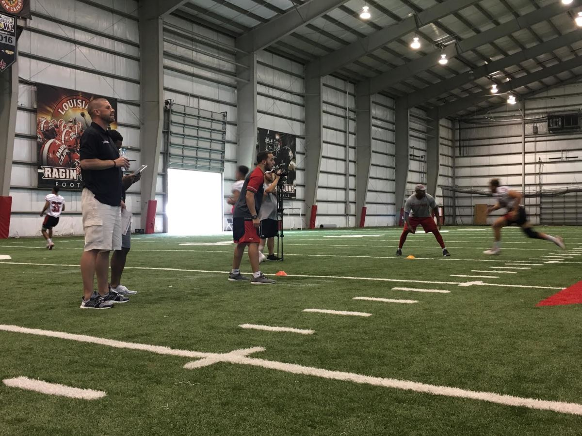 Billy Napier watches walk-ons participate in workouts inside Louisiana's indoor facility.