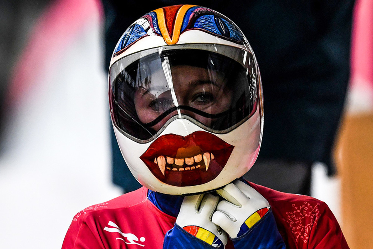 Romania's Maria Marinela Mazilu puts on her helmet to take part in the women's skeleton training session at the Olympic Sliding Centre during the Pyeongchang 2018 Winter Olympic Games in Pyeongchang on February 14, 2018.