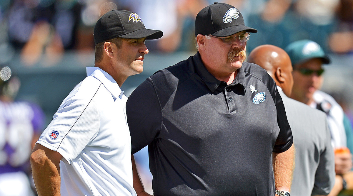 John Harbaugh, pictured here with Andy Reid before a game in 2012, was the special teams coordinator and defensive backs coach or the Eagles from 1998-2007.
