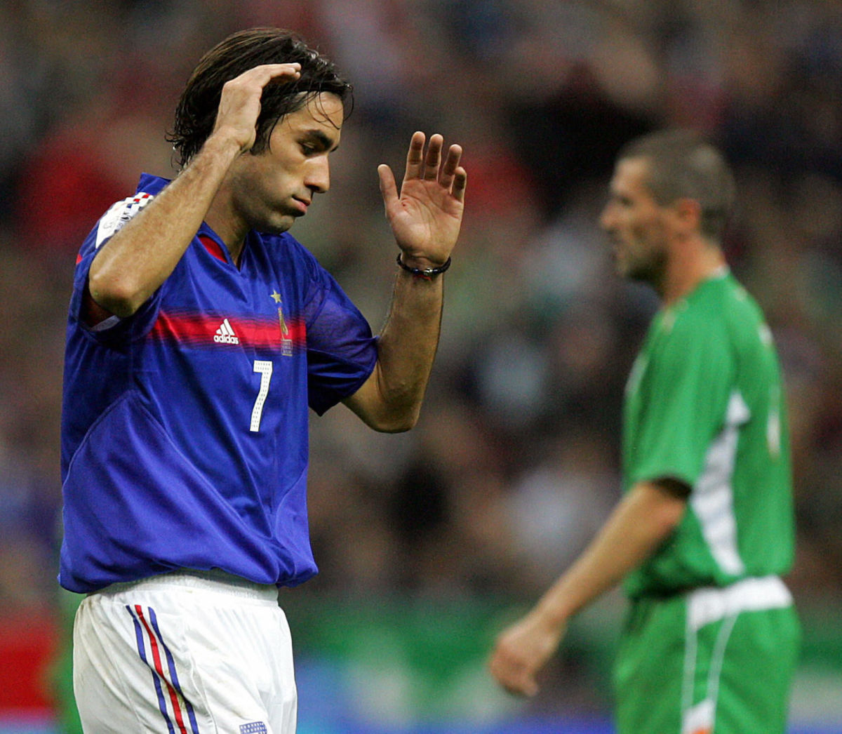 french-forward-robert-pires-looks-deject-5b3a79a5347a0234c900001c.jpg