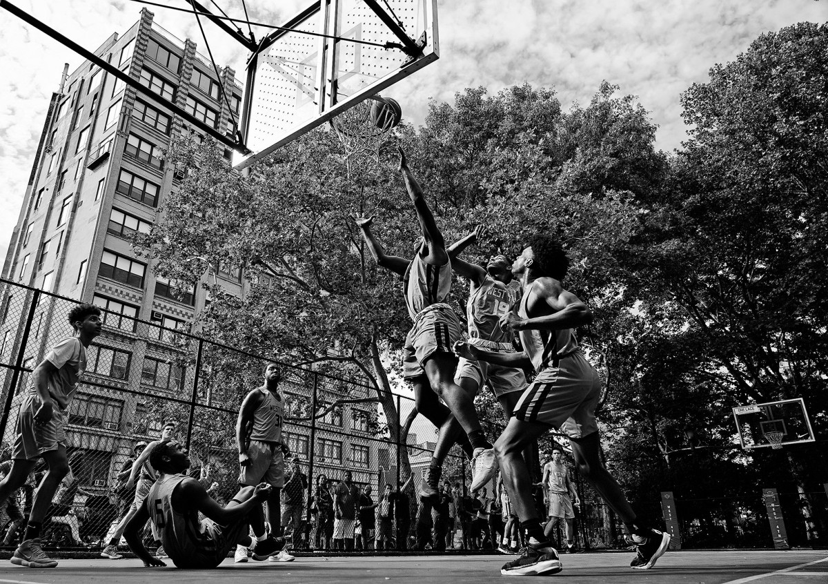 Kids play basketball on the Lower East Side in Manhattan, New York