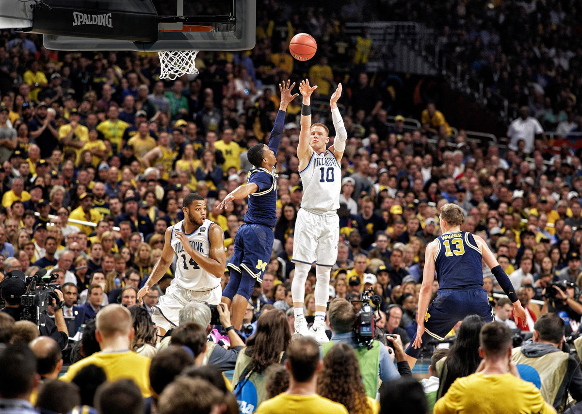 Villanova's Donte DiVincenzo shoots a three-pointer against Michigan in the NCAA tournament