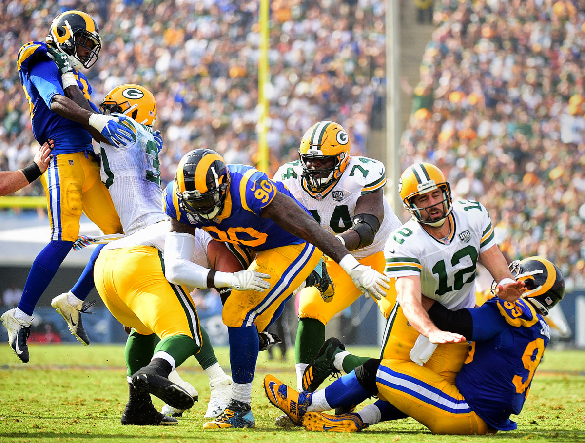 Green Bay Packers QB Aaron Rodgers against Aaron Donald of the Los Angeles Rams