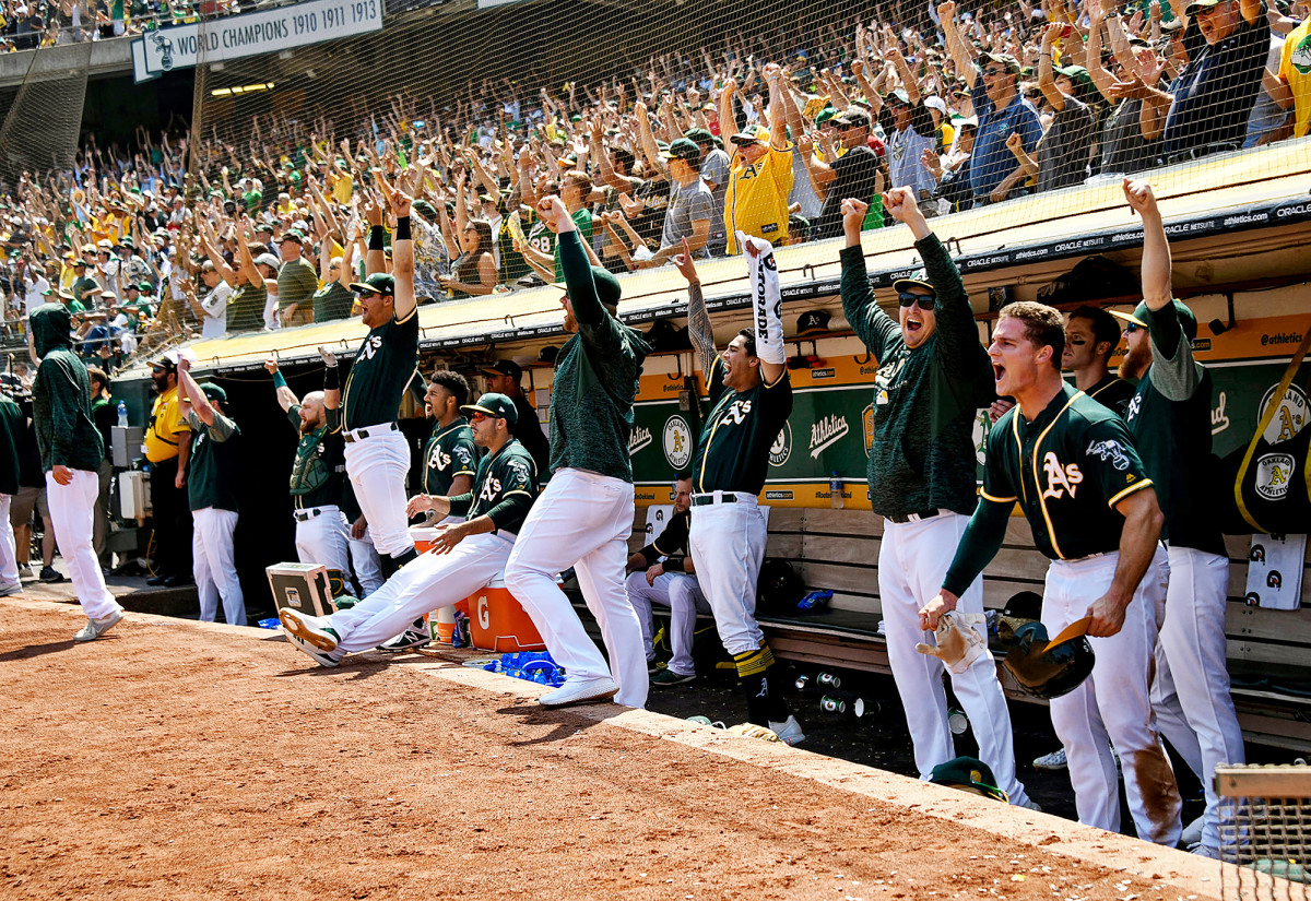 Oakland Athletics dugout in a game against the Houston Astros