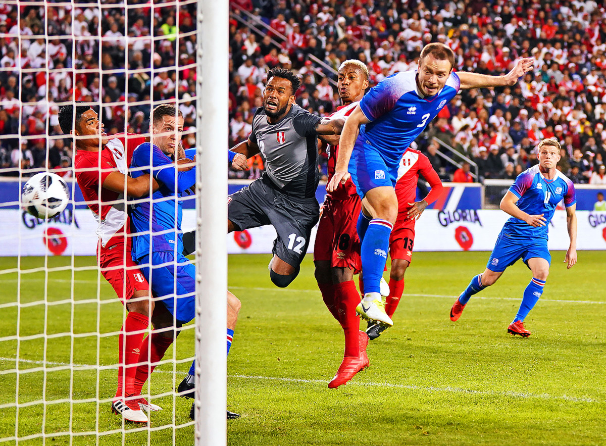 Iceland's Jon Gudni Fjoluson scores a goal vs. Peru during an international friendly