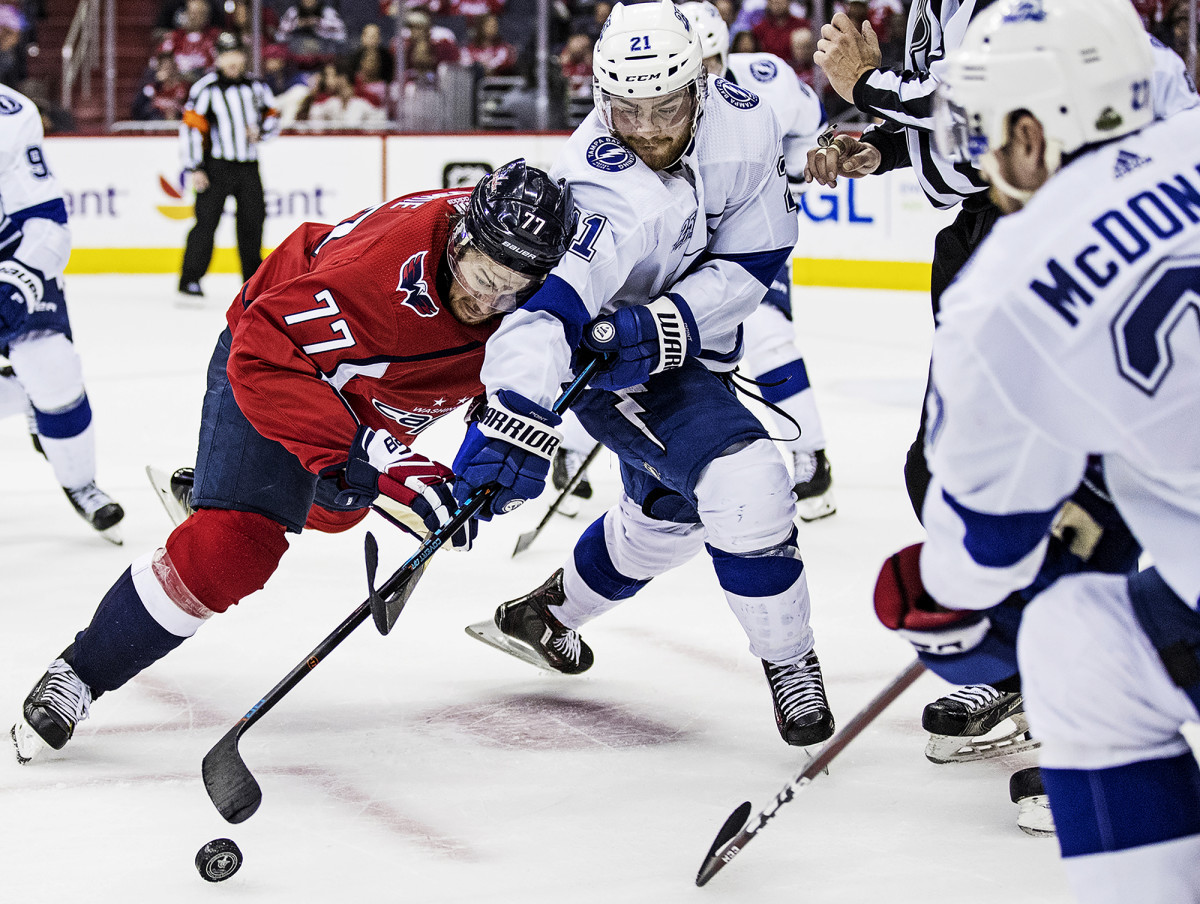 T.J. Oshie of the Washington Capitals vs. Tampa Bay Lightning's Brayden Point in Game 3 of the NHL Eastern Conference Finals