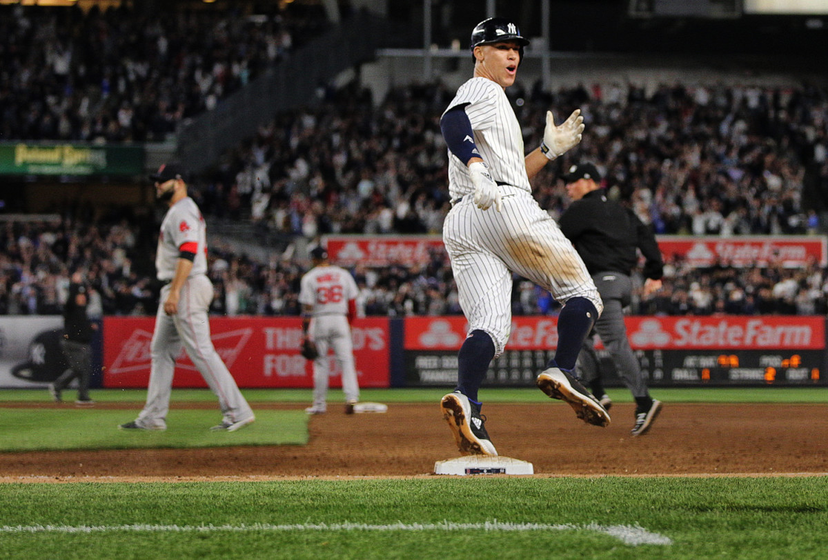 Aaron Judge of the New York Yankees celebrates a homerun against the Red Sox