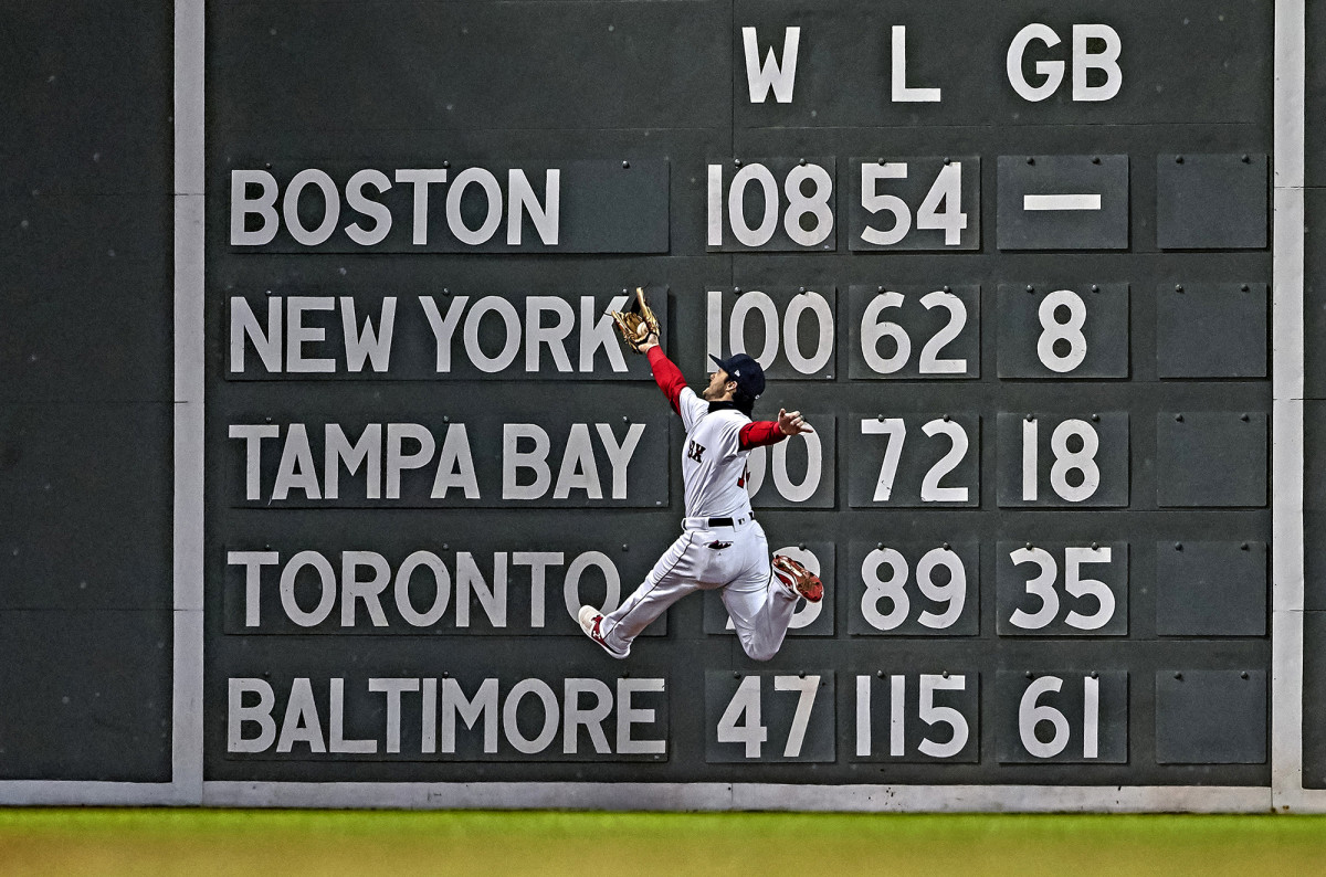 Red Sox left fielder Andrew Benintendi makes a catch during Game 2 of the World Series against the Dodgers