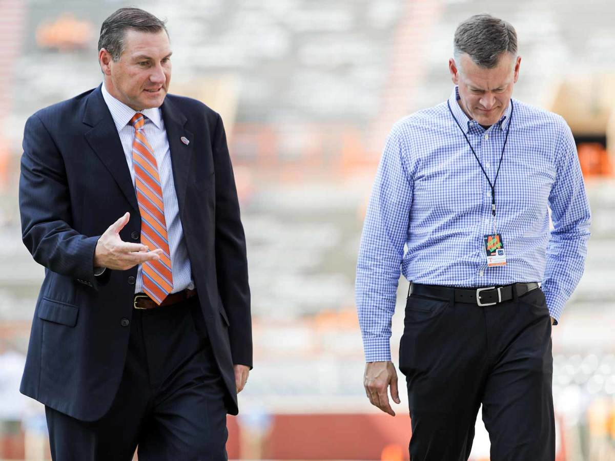 Dan Mullen and Scott Stricklin (right) were reunited in Gainesville last winter after working together in Starkville for nine years.