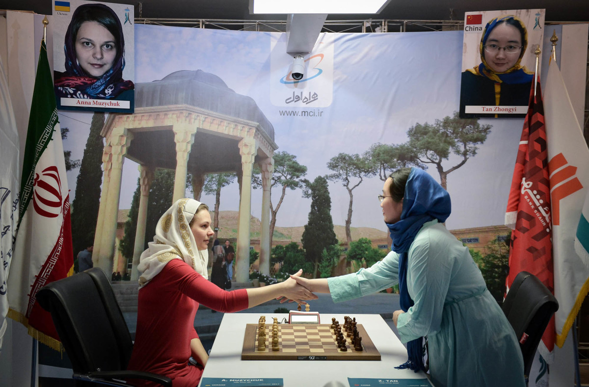 Anna Muzychuk of Ukraine plays against Tan Zhongyi of China during the final day of the Women's World Chess Championship 2017.