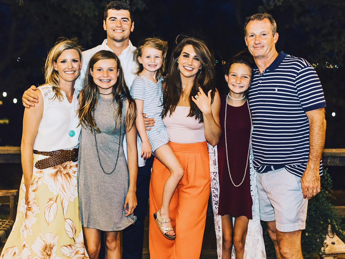 Stidham with his fiancée Kennedy Brown (in orange pants) and the Copelands.