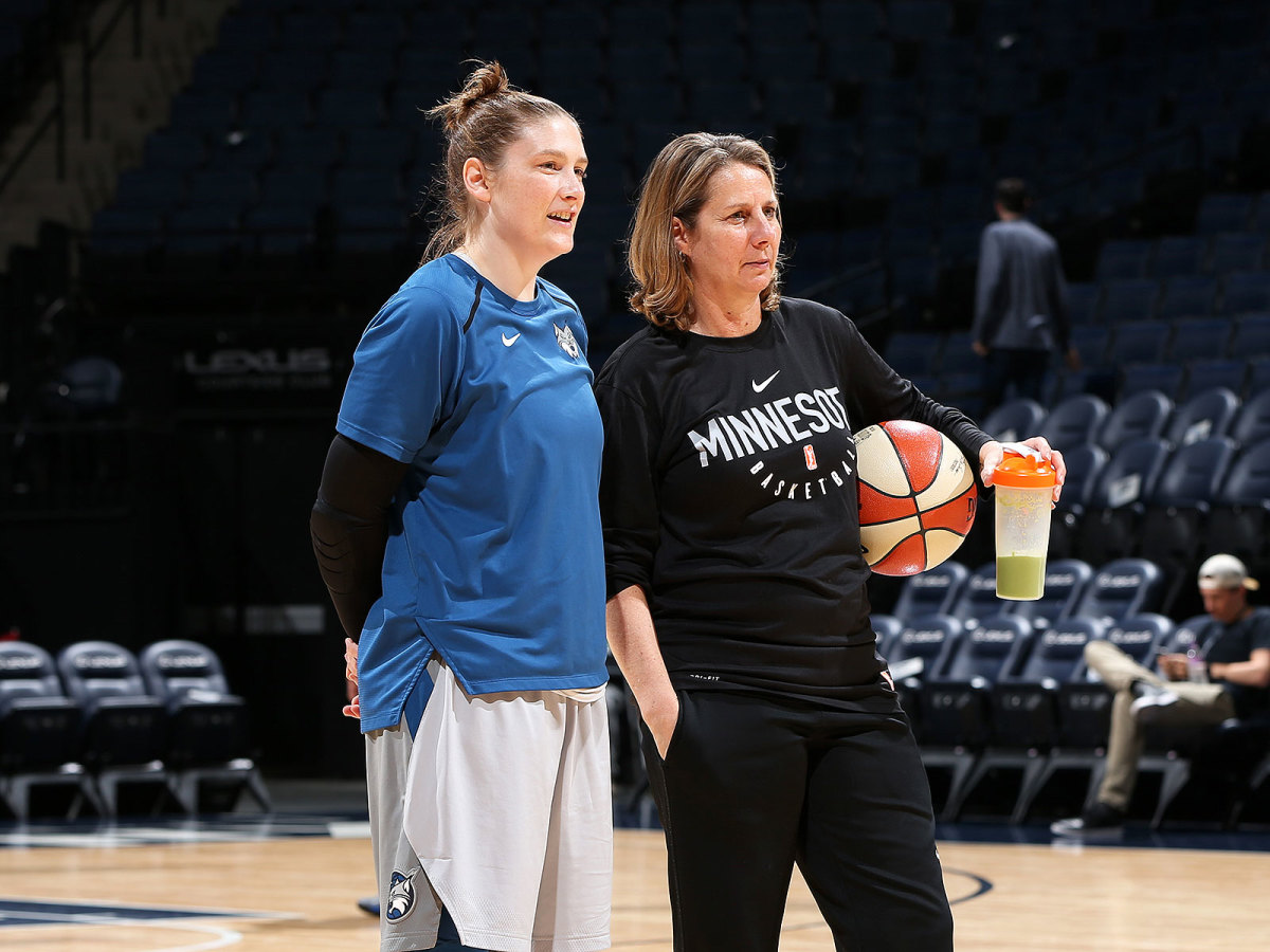 Whalen (left) talks with Minnesota Lynx head coach Cheryl Reeve before an WNBA game in June 2018