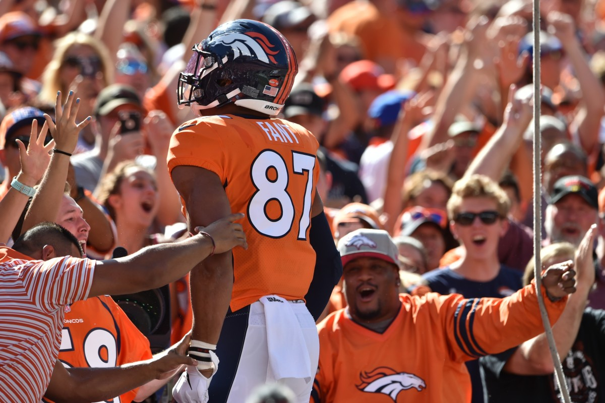 Denver Broncos tight end Noah Fant (87) celebrates his touchdown with the fans in the south stands against the Jacksonville Jaguars at Empower Field at Mile High.