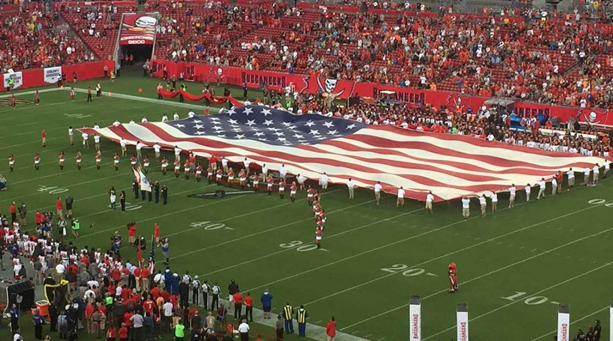The flag is rolled out in Tampa before Bucs-Browns.