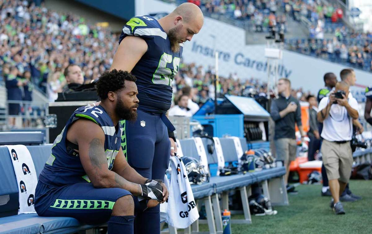 Teammate Justin Britt stood next to Michael Bennett as he sat during the anthem in Seattle.