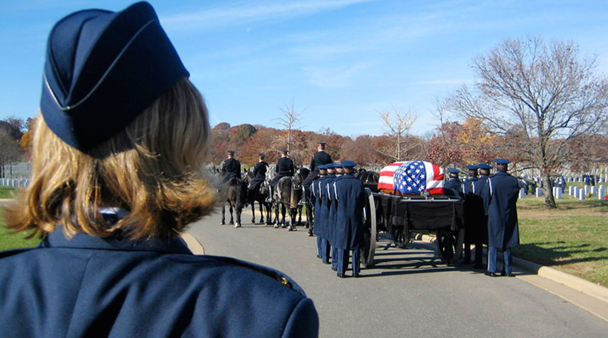 Sharon walking behind her father's casket at Arlington.