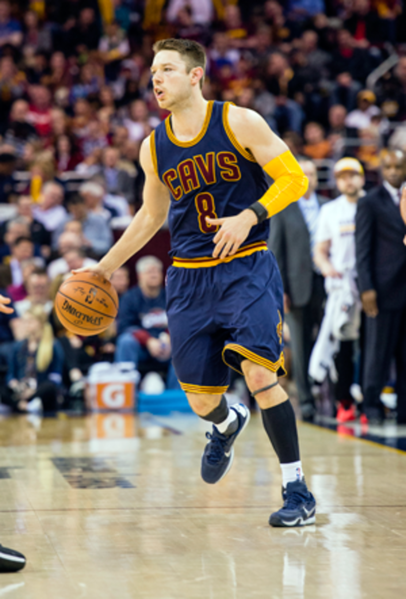 Matthew Dellavedova, wearing a WHOOP device on his left wrist, runs the point for the Cavs in March 2016.