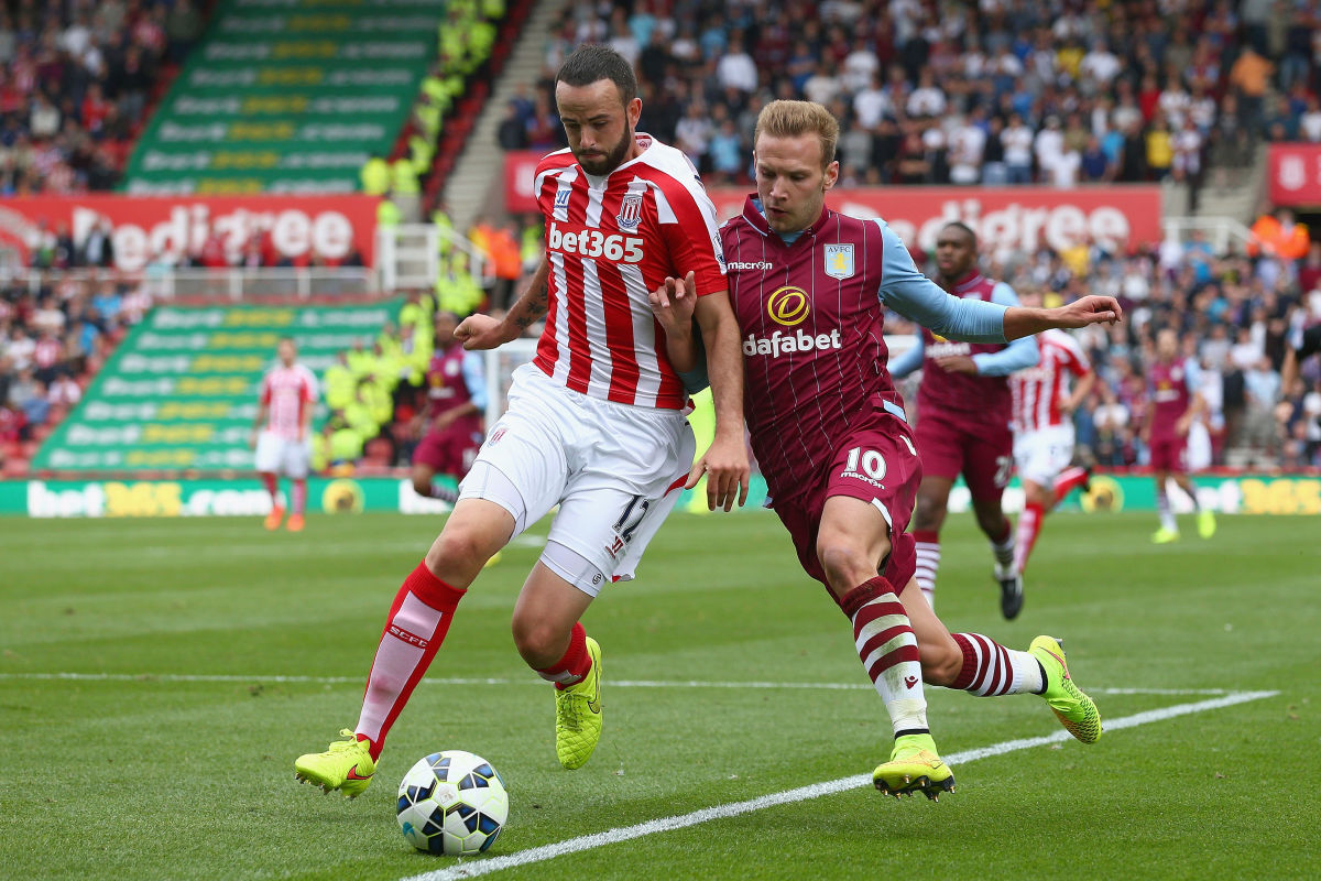 STOKE ON TRENT, ENGLAND - AUGUST 16: Marc Wilson of Stoke City in action with Andreas Weimann of Aston Villa during the Barclays Premier League match between Stoke City and Aston Villa at Britannia Stadium on August 16, 2014 in Stoke on Trent, England.  (Photo by Clive Brunskill/Getty Images)