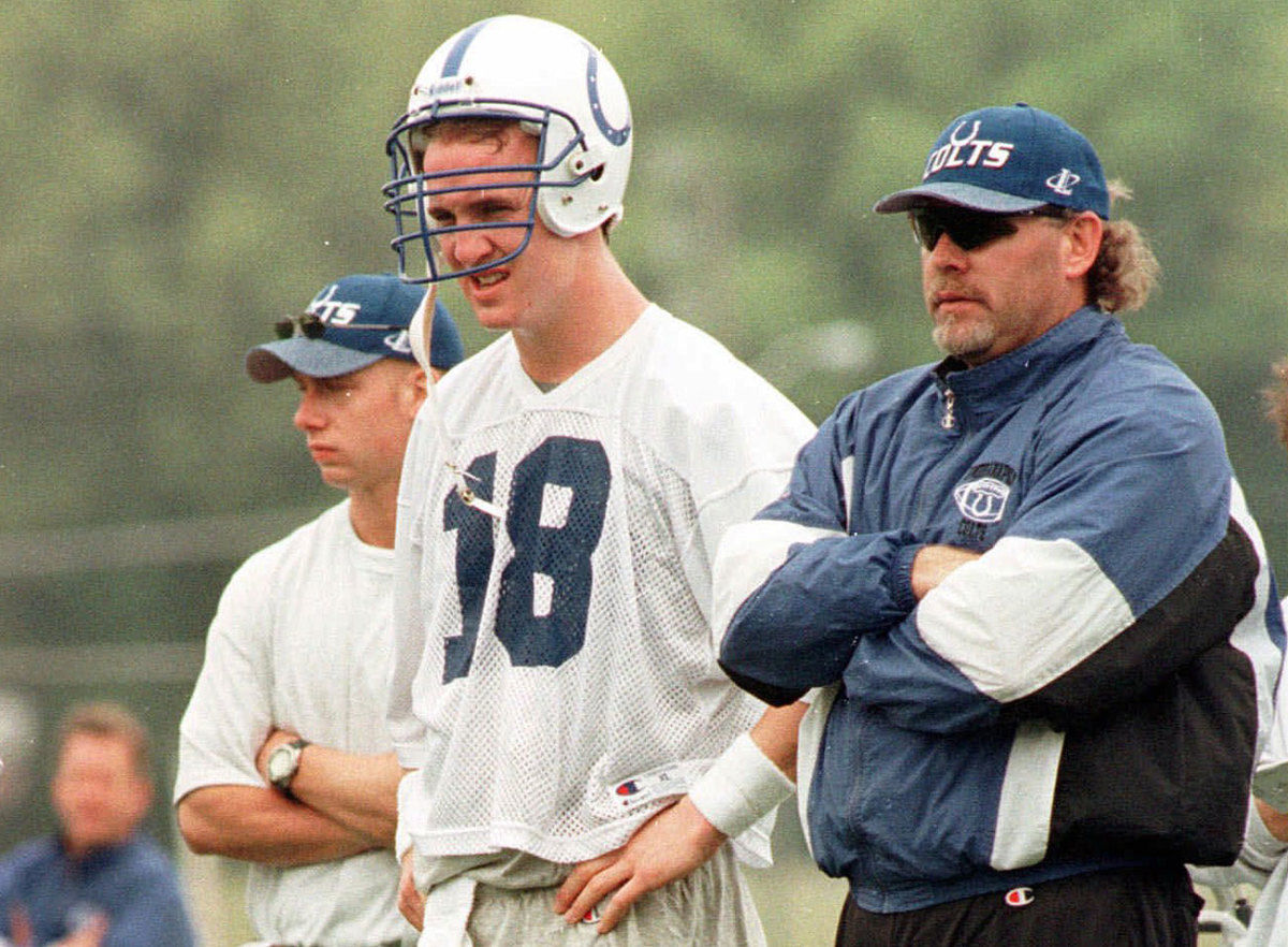 Peyton Manning and Bruce Arians (right) watch Colts practice during the team's minicamp in 1998.