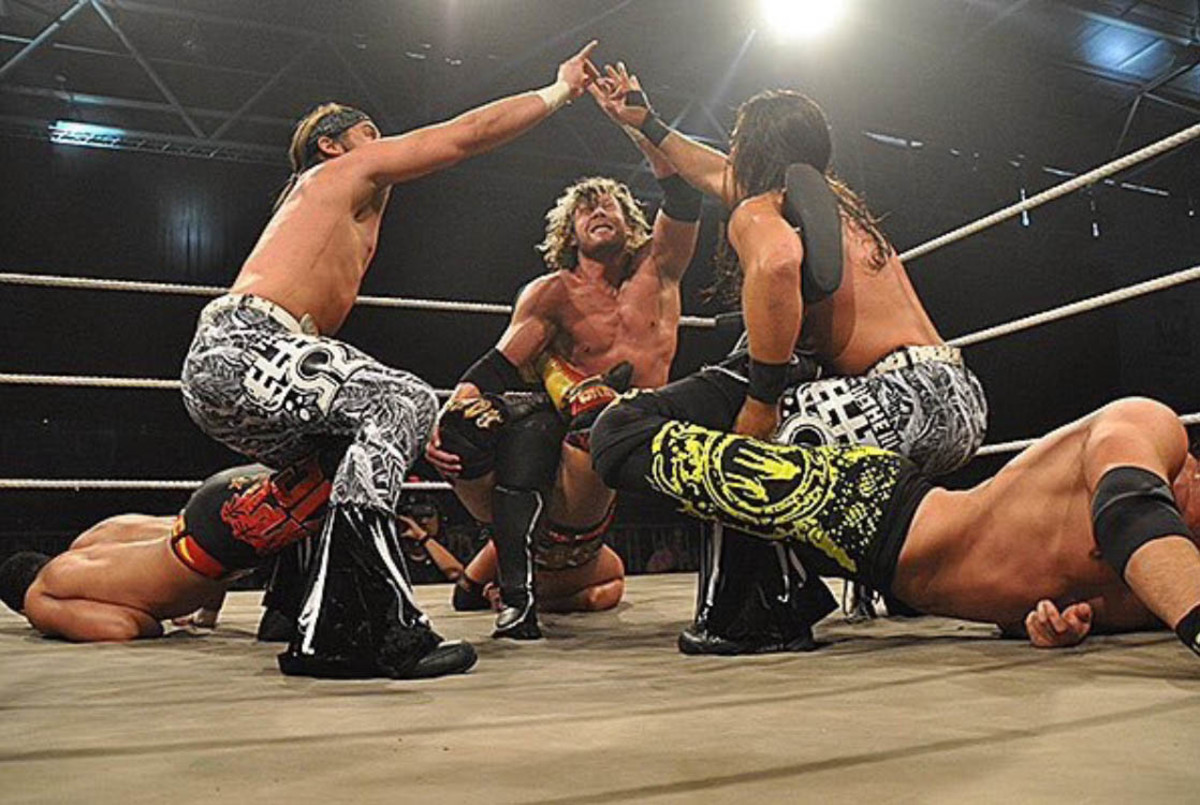 Courtesy_Kenny Omega_too sweet with Young Bucks.jpg