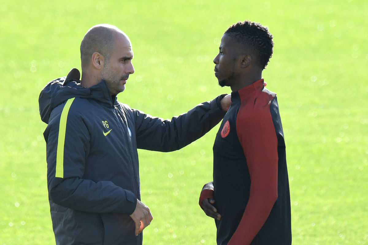 Manchester City's Spanish manager Pep Guardiola (L) talks with Manchester City's Nigerian striker Kelechi Iheanacho (R) during a team training session at Manchester City Football Academy Campus in Manchester, north west England, on October 18, 2016 ahead of their UEFA Champions League Group C football match against Barcelona at the Camp Nou on October 19.  / AFP / Anthony Devlin        (Photo credit should read ANTHONY DEVLIN/AFP/Getty Images)